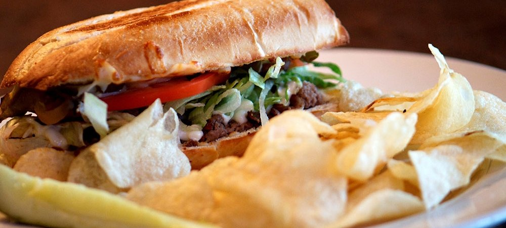 Steak and Cheese hoagie with chips